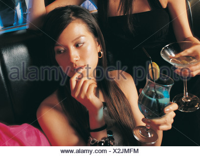 High angle view of a young woman in a bar - Stock Photo