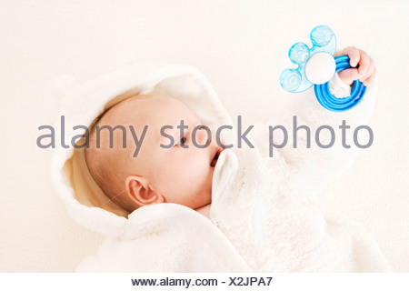 baby boy with teething ring - Stock Photo