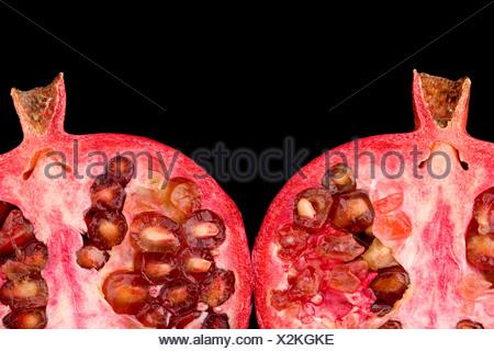 Pomegranate halves - Stock Photo