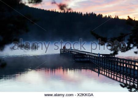 Sweden, Dalarna, Orsa Finnmark, Lake Tallsjon at sunset - Stock Photo
