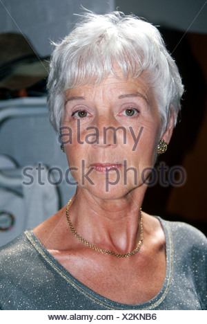 Unhappy elderly woman with sulfur gray hair serious look a camera, natural woman looking at camera serious face - Stock Photo