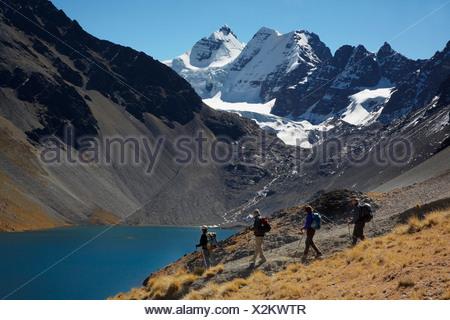 Trekkers With Condorri Peak Behind - Stock Photo