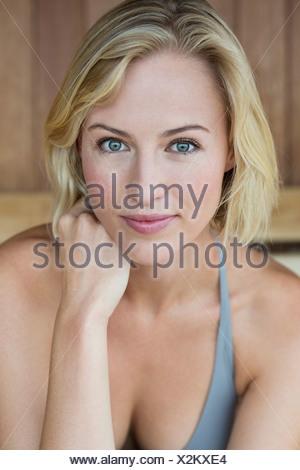 Portrait of a beautiful woman in a sauna - Stock Photo