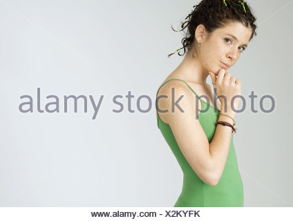 Young woman with hand under chin, portrait - Stock Photo