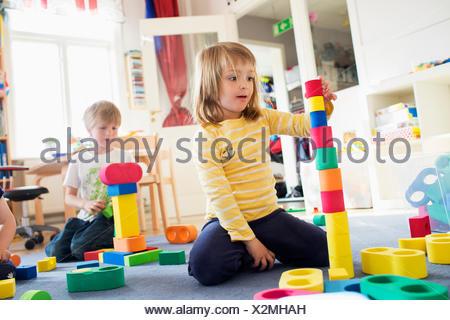 Sweden, Children playing in kindergarten - Stock Photo