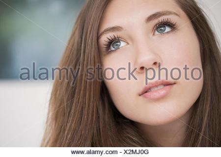 Teenage girl thinking - Stock Photo