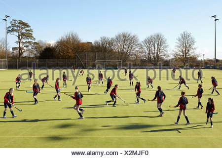 Lacrosse players in game on field - Stock Photo
