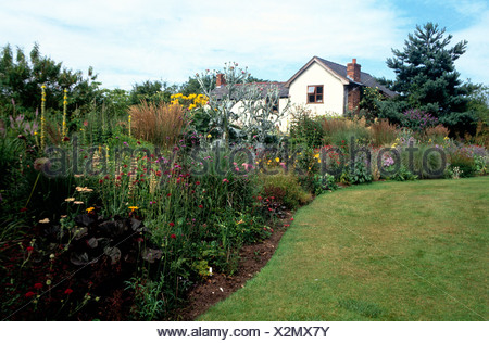 Donadea Lodge, Babell, Flintshire Garden neat green lawn and curved ...