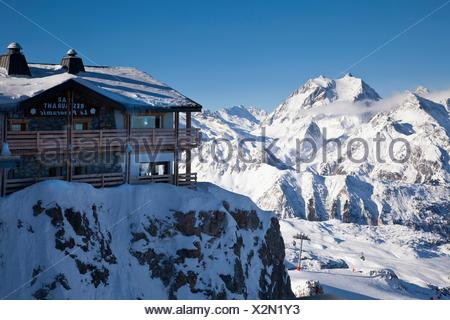 Le Panoramic restaurant with mountains in the background, Courchevel 1850, France - Stock Photo