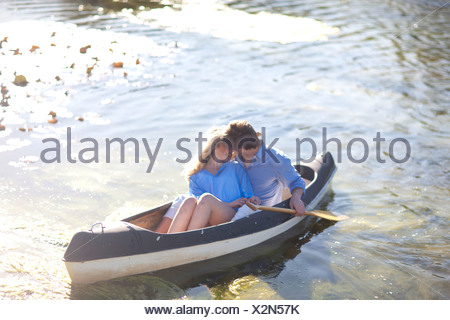 Young romantic couple in rowing boat on river - Stock Photo