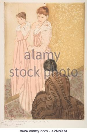 The Fitting. Artist: Mary Cassatt (American, Pittsburgh, Pennsylvania 1844-1926 Le Mesnil-Théribus, Oise); Date: 1890-91; Medium: Drypoint and - Stock Photo