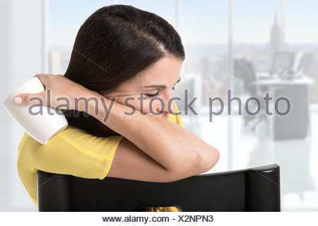 Businesswoman Sitting in a Chair Sleeping - Stock Photo