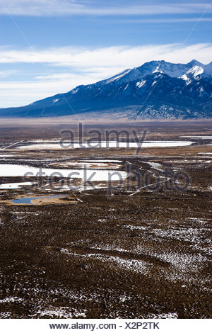 Aerial scenic landscape of mountains and plains in rural Colorado United States - Stock Photo
