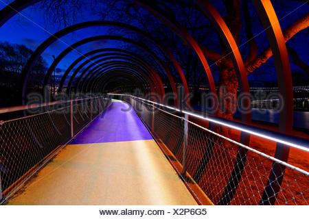 Rehberger Brücke (bridge) 'Slinky Springs to Fame', in the dusk, Oberhausen, North Rhine-Westphalia, Germany, Europe - Stock Photo
