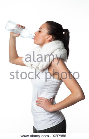 Young sportswoman drinking water - Stock Photo
