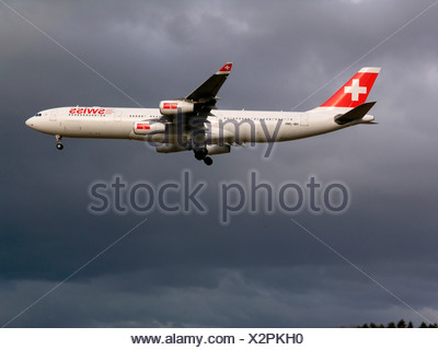 Switzerland Swiss international air lines Airbus A340 flying flight sky clouds cloudy aviation aircraft aeroplane plane - Stock Photo