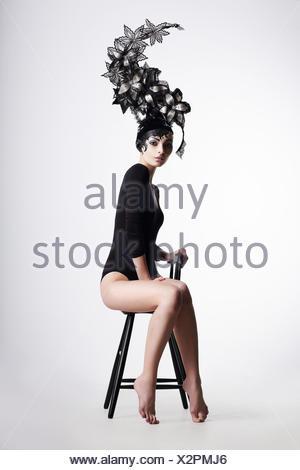 Artistic Fancy Woman wearing Extraordinary Fancy Headdress - Stock Photo