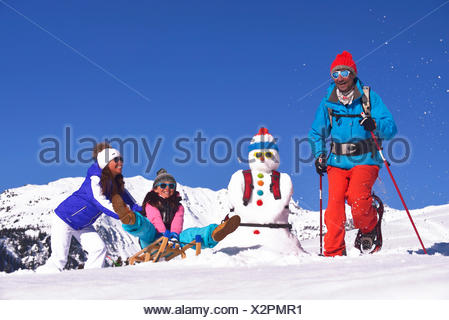 Family in snow holidays, France - Stock Photo