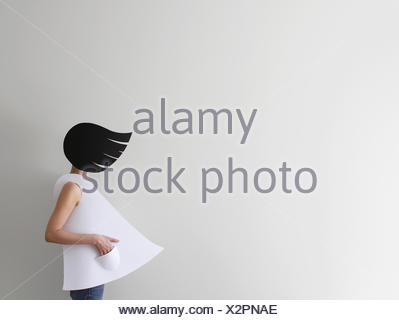 Conceptual woman with windswept hair and clothes - Stock Photo