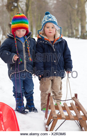 Two little boys in the snow - Stock Photo