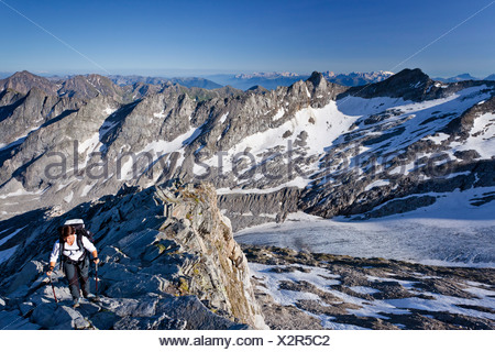 Mountaineer climbing Hochfeiler mountain, Pfitschertal valley, Eisacktal valley and Wipptal valley at the back, Dolomites - Stock Photo