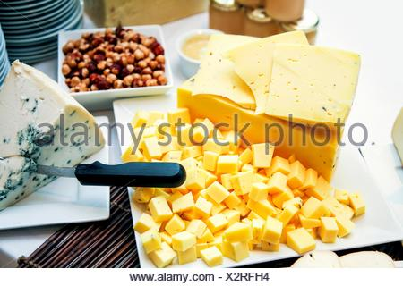 Assorted Cheese; Cubes and Wedges; Mixed Nuts - Stock Photo