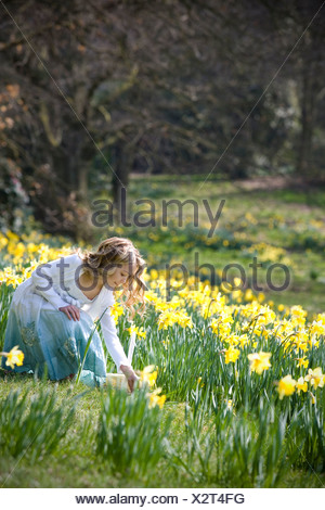A young girl collecting Easter eggs - Stock Photo
