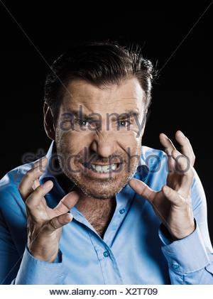 caucasian man unshaven anger portrait isolated studio on black background - Stock Photo