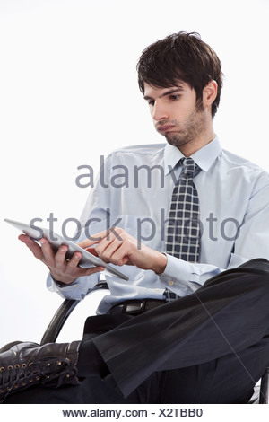 Businessman using tablet pc - Stock Photo