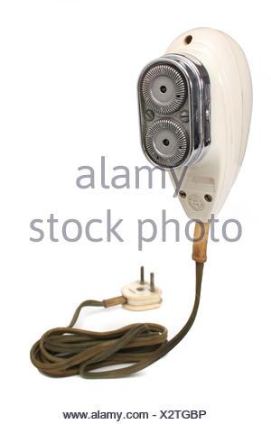 antique retro razor shaver old men man isolated antique electric cable hygiene - Stock Photo