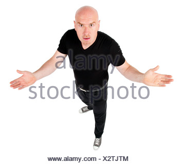 bald headed man looking challengeing into the camera - Stock Photo