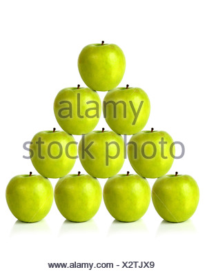 green apples on a pyramid shape - Stock Photo