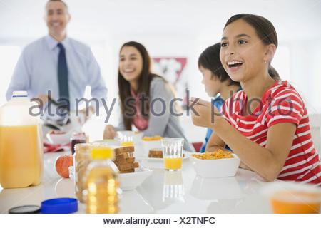 Girl eating breakfast cereal - Stock Photo