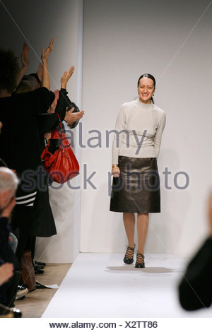 Anne Klein New York Ready to Wear Autumn Winter Fashion designer Isabel Toledo wearing brown leather skirt, beige jumper square - Stock Photo