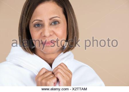 woman wearing bathrobe - Stock Photo