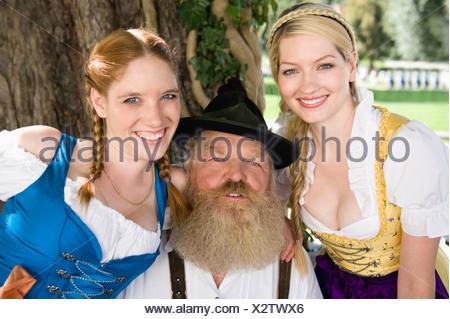 Germany, Bavaria, Upper Bavaria, Senior man and two women, portrait - Stock Photo
