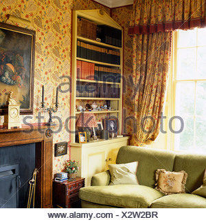 Floral Curtains And Pedimented Alcove Bookcase Behind Sofa Next To  Fireplace In Country Living Room With