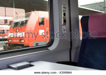 Train compartment, seat, sockets, windows, view, nobody, trajectory carriage, train, compartment, inside, seat compartment, seat, pillow, connections, computer connection, connection, locomotive, German Railways, train journey, travelling, moving, on the way, mobile, - Stock Photo