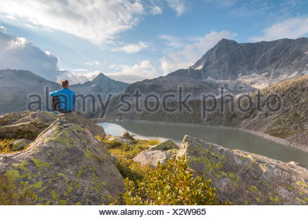 Hicker admire the Adamello Mount. Temù, Val d'Avio (Adamello Park), Brescia province, Lombardy, Italy, Europe - Stock Photo
