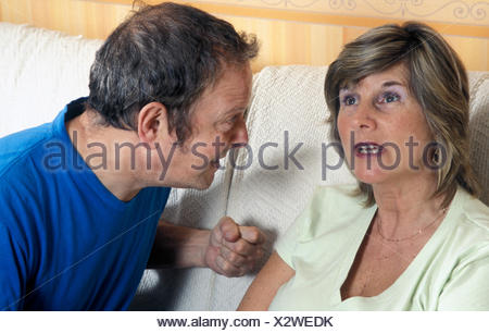 middle aged couple having argument - Stock Photo