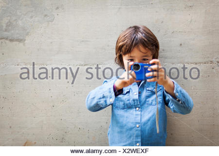 Little boy taking a picture   digital camera - Stock Photo