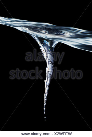 Vortex forming in water - Stock Photo