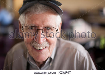 Portrait of senior man, smiling - Stock Photo