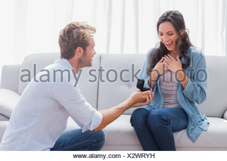 Handsome man doing a marriage proposal - Stock Photo