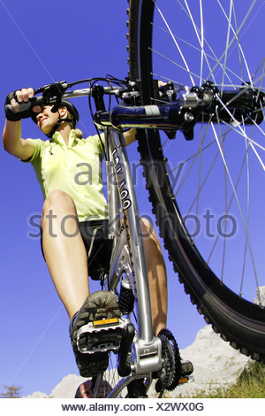mountainbiker in worms-eye view - Stock Photo