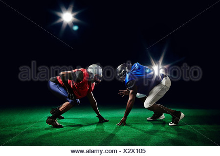 Two american footballers crouching - Stock Photo