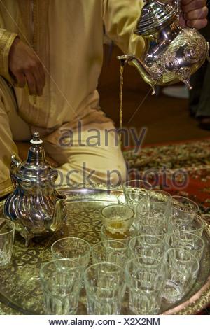 Serving peppermint tea, Arabia - Stock Photo