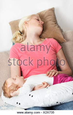 Sweden, Vastra Gotaland, Gothenburg, Mother with daughter (12-17 months) sleeping - Stock Photo