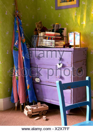 Toy wigwam and purple painted chest in corner of childrens room - Stock Photo