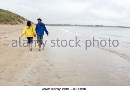 Couple on beach in love - Stock Photo